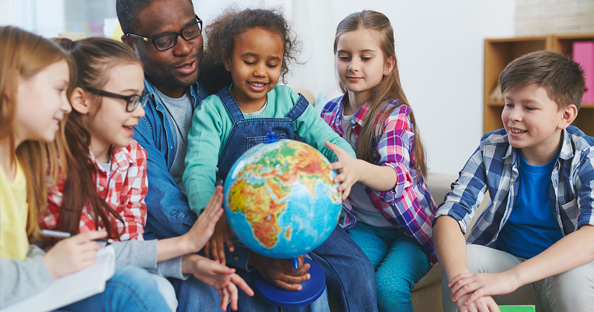 Globe with teacher and students